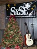 The Guitar by the tree wasn't a present it was a Raffle Prize donated to us by Star Music ... Located right beside The Historic Myrtle Beach Train Depot . THANK YOU STAR MUSIC